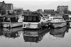 Brayford Pool (lincoln_eye) Tags: uk greatbritain england urban blackandwhite water monochrome marina buildings reflections boats spring europe apartments unitedkingdom eu overcast lincolnshire lincoln gb april ripples carpark offices 2014 brayford dithering gmic