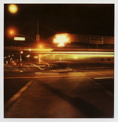 Ghost Bus 28 (tobysx70) Tags: california ca street door light toby motion blur color bus film fountain sign night project polaroid sx70 for spring neon nocturnal traffic south ghost may trails halo fair illuminated route pharmacy tip cameras 600 type mission week soda lit rollers pasadena hancock crosswalk oaks 88 avenue slr680 rt rte reject impossible roid the 2014 polaroidweek frankenroid impossibleproject tobyhancock impossaroid