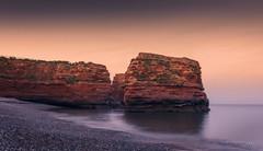 Dusk Til Dawn (Bruus UK) Tags: ocean sunset sea summer sky cliff seascape beach landscape evening coast marine rocks pentax dusk stones tide shingle calm devon sultry nationalgeographic ladrambay