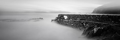 swamped (Nick green2012) Tags: uk longexposure bw white seascape black abandoned broken wet water monochrome rock misty dark coast still cornwall harbour cliffs coastal filter beaches seafront filters remains rugged hightide breakwater stopper whitsand 10stop iplymouth stormymoody