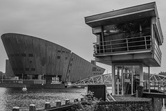 (McQuaide Photography) Tags: city blackandwhite bw holland building water netherlands monochrome amsterdam architecture canon eos blackwhite europe nederland structure dslr modernistarchitecture modernarchitecture stad 100d mcquaidephotography