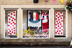 Le Tour 171 (Peter.Bartlett) Tags: uk reflection window bike sign poster unitedkingdom cycle shopwindow tourdefrance shopfront westyorkshire holmfirth stage2 bunting letour holmevalley m43 kirklees granddepart microfourthirds peterbartlett olympusomdem5