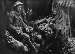 WWI2013N1 (ww1images) Tags: relax soldier post mud sleep cigarette smoke helmet cable rest british doze dugout troops weary corrugatediron sandbag allied puttee briodie funkhole trenchtelephone