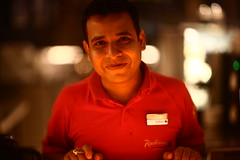AKBAR the RED (N A Y E E M) Tags: waiter portrait red night light bokeh portbar lobby hotel radissonblu chittagong bangladesh sooc raw unedited untouched availablelight indoors akbar 8000