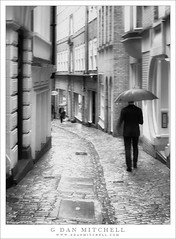London Rain (G Dan Mitchell) Tags: rain weather london england unitedkingdom uk street man photography cobbles narrow blackandwhite monochrome travel