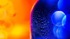 Cold and Warm (Ook Pik) Tags: 7dwf macromondays orangeandblue orange blue macro bottle droplets water panasonic lumix gh4 425mm f17 coldandwarm hmm light backlit backlight bokeh dof mm background color contrast couleurs bouteille eau gouttes bleu freetheme flickrheroes microfourthirds micro43