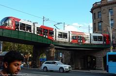 Sydney Light Rail - LRV2123 arrives at the Railway Colonnade (2) (john cowper) Tags: sydneylightrail lrv2123 eddyavenue railwaycolonnade railwayheritage bridge overbridge urbos3 centralrailwaystation sydneypublictransport lightrailvehicle lightrail sydney newsouthwales