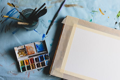 Art in progress (Sober Rabbit) Tags: art beginning brushes brush colors creativity desk deskfromabove empty gettinginspired painting paper table watercolor