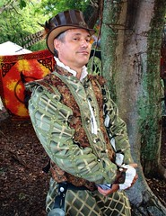 The Sly Poet [explore] (PelicanPete) Tags: floridarenaissancefestival march2017 25thannual deerfieldbeachflorida florida southflorida unitedstates usa renaissancefestival armsandarmor joust thejoust knights horses action emotion excitement skill kingsroyalorders fieldofdreams horse horsebackrider knight battle gear helmet shield lance sword noblecauseproductions sanantoniotexas viewingstand nobleattire portraitsofrenfest portrait people smile outdoor fun pose greatfacesofrenfest festivalemployee sunlit walk stroll costume happy face shadow closingday cast castofcharacters farewell faretheewell eatdrynkandbemerrie theslypoet hat arthurgreenleafholmes 461 explore exp326 interesting explored bestposition461~42016