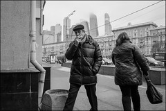 DR151210_0958D (dmitry_ryzhkov) Tags: cap corner crosswalk look looks eye eyecontact contact smoke smoker smoking cigarette tabak couple day daylight two motion movement walk walker walkers pedestrian pedestrians sidewalk art city europe russia moscow documentary journalism street streets urban candid life streetlife citylife outdoor outdoors streetscene close scene streetshot image streetphotography candidphotography streetphoto candidphotos streetphotos moment light shadow people citizen resident inhabitant person portrait streetportrait candidportrait unposed public face faces eyes man men woman women lady sony alpha black