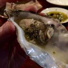 Oyster with pickled pine.