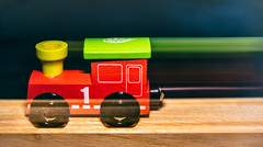 Ghost train (LoomahPix) Tags: blur closeup flickr green intentionalblur macro macromondays macrophotography red toy train wood wooden 7dwf