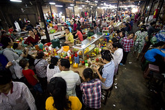 inside Siem Reaps Old Market. (DominicStafford.) Tags: people food cooking breakfast dinner dark asian lunch restaurant cambodia southeastasia khmer market rustic large wideangle busy inside siemreap cheap streetfood seller 1022mm oldmarket 2014 hygeine psarchas