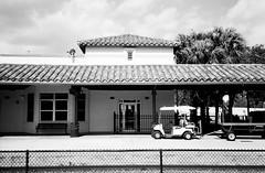 Seaboard Air Line Station Ft Lauderdale (Phillip Pessar) Tags: camera bw white black film analog train 35mm store florida zoom kodak infinity tx trix rail railway olympus x thrift 400 lauderdale ft tri 70