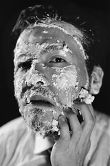 Peel Away the Layers (hieburt1) Tags: portrait blackandwhite bw man tlr film analog mediumformat studio peeling makeup surreal headshot 120mm tmax100 welldressed yashicamatem