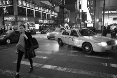 NYC (craigrkr) Tags: street city nyc newyorkcity urban blackandwhite bw girl crossing manhattan cab taxi human crosswalk 2014