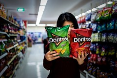Tough Choices... (Photos By Dlee) Tags: portrait food girl canon asian person dof bokeh chinese foodporn shops grocery choices product decision doritos 6d bokehlicious canon6d canonef35mmf2is photosbydlee photosbydlee13