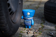 Uglyworld #2292 - Pitstops Helperer - (Project On The Go - Image 124-365) (www.bazpics.com) Tags: blue winter summer home wool hat car wheel hub project jack toy one 1 blog pretty cookie day action handmade crochet vinyl may knit 4th help website ugly figure formula change cave 365 nut adventures custom uglydoll pitstop baz tyres tyre loose wedgie uglydolls 2014 wedgehead uglyworld barryoneilphotography adventuresinuglyworld uglyadventures