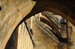 DSC_9004 [ps] - Over the Heads (Anyhoo) Tags: old uk england tower stone architecture carved arch cathedral decoration hampshire carving glimpse winchester lowsun cornice buttress winchestercathedral flyingbuttress hants normanarch intrados pointedarch anyhoo photobyanyhoo