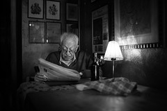 In company of light and a botte of wine (Giulio Magnifico) Tags: life lighting city light urban inspiration history glass composition contrast vintage dark relax lights newspaper bottle thought alone loneliness shadows emotion expression character citylife thoughtful streetphotography streetportrait silence elder essence aged osteria udine nikond800e sigma35mmf14dghsm