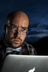 Contemplating my edits (pumped2run) Tags: portrait nerd night self computer stars glasses mac laptop bald trails tie bowtie bow plaid contemplate selfie