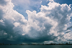 Looming (OzGFK) Tags: ocean sea sky film water clouds analog port singapore asia afternoon harbour sunny malaysia punggol jb nikkor johorbahru nikonfm3a
