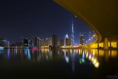 El Abraj Bridge (Damien Borel) Tags: longexposure night stars dubai waterreflections manualblending burjkhalifa boblastic damienborel elabrajbridge elabraj