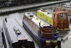 Docked (Lawrence OP) Tags: rain boats canal edinburgh union jogger
