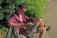 Reading on a Bench (4440) (ViewFromTheStreet) Tags: street new york city nyc newyorkcity newyork man male guy classic sunglasses shirt paper photography reading calle amazing unitedstates centralpark manhattan candid chest streetphotography shorts bigapple blick unbuttoned allrightsreserved viewfromthestreet stphotographia vftsviewfromthestreet blickcalle copyright2014 ©copyright2014blickcalle blickcallevfts ©blickcallevfts