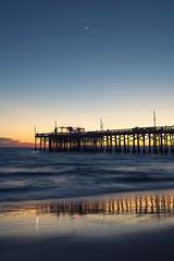 Sunset in Newport Beach (neosmultimedia.com) Tags: blue sunset orange sun moon seascape reflection beach wet evening pier catalina sand newportbeach socal newport shore moonlight southerncalifornia orangecounty balboa rubys neos neosdesign