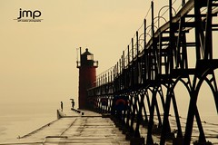 South Haven Lighthouse in the rain! (Jeff Meeker) Tags: summer lake rain umbrella shopping michigan lakemichigan flickrcentral southhaven outdoorphotos lifepreservers michiganlighthouses outdoorphotography southhavenlighthouse outdoorbeauty outdoorphotographer allthingsmichigan lifeinwestmichigan fourseasonsgroup puremichigan photographersofwestmichigan groupswithexperience michigangottaluvit