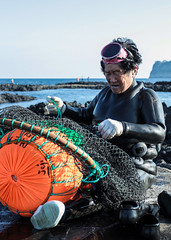 65 Year Old Grandmother Diver (DMac 5D Mark II) Tags: ocean old sea woman inspiration coast grandmother traditional diving will shore shellfish seafood strong southkorea jeju cultural independant catchoftheday