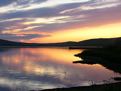 Sunset over Kirbister loch (stuartcroy) Tags: sea sky white reflection water weather island scotland still sand orkney scenery panasonic wildflowers dmcfz10 scapaflow infinitexposure