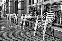 Silver chairs. (Ian Ramsay Photographics) Tags: chinatown haymarket sydney newsouthwales australia chairs moist rain night previous positioned prepared