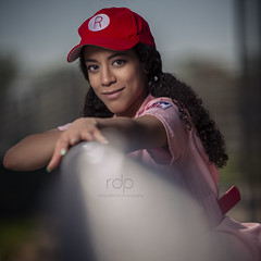 Aislynn_web2 (rdeloviar) Tags: photoshoot portrait portraiture baseball theme women league ball cap red white pink leading lines bokeh tamron curls strobist off camera flash