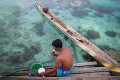 Indonesia (slow paths images) Tags: indonesia asia sulawesi togianislands malengeisland sea water clear corals man bajau asian sitting boat remote dailylife travel