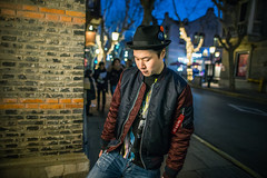 Young man lower his head (HIKARU Pan) Tags: night photography portrait shanghai chinese china asia xintiandi fashion youngman outdoors light 24l canonef24mmf14liiusm 1dx eos1dx standing