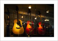 Guitar trio (G. Postlethwaite esq.) Tags: derby foulds irongate sonya7mkii sonyalphadslr guitar keyboard musicalinstrument photoborder reflection shop spotlights window artisticusfarticuscopy