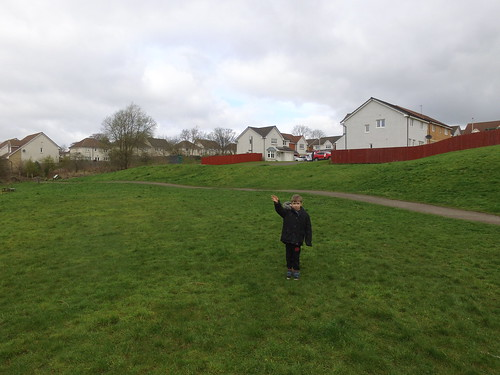 Alex waving at the drone