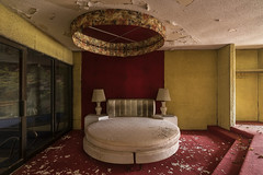 Crawl down dead lovers lane. (Element1983) Tags: abandoned bed lost decay resort sony forgotten room sonya7ii lamps light shadow rug red yellow ziess 18mm prime lines romantic