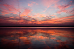 Zen (LynxDaemon) Tags: sunset blue sky clouds paintinglike white dark light pink warm cold colorful saturation water