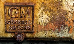 General Motors......    Explore (Kevin Povenz Thanks for the 3,000,000 views) Tags: 2017 april kevinpovenz ottawacounty ottawa outdoor gm generalmotors rust old canon7dmarkii sigma70mmmacro rusty bolt label emblem orange yellow square