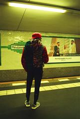 Ronan (davorzup) Tags: canon ae1 film filmisnotdead istillshootfilm analog analogsunrise travel april 2017 berlin germany potsdamer platz person standing tram subway ubahn waiting colorful coat hat yellow 28mm man people