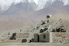Kyrgyz Stone Dwellings Xinjiang Uyghur Autonomous Region China - EXPLORED (eriagn) Tags: stone dwelling habitation nomadic goat yurt livestock milk goathair weaving enclosure animal protection shelter livelihood kyrgyz men ethnic bactriancamel camel horse karakullake muztaghata chinanationalhighway314 karakoramhighway kkh sanddune river dune mountain snow peak stonebuilding highway road highaltitude scenic landscape remote rugged geology eurasianplate indianplate tectonics sarykol yellowlake gezrivercanyon ghezriver murztaghata kyrghiz pakistan pamir kunlun silkroad traderoute ngairehart ngairelawson eriagn threadsinthesand expedition travel adventure photography route asia china centralasia farwesternchina cold kongershan explore explored earthslandscapes
