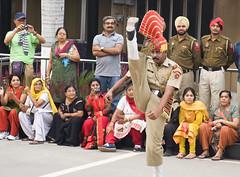 Kungfu Kicks! (wandervox) Tags: pakistan sunset india evening nikon flag military border ceremony retreat colourful patriot patriotism lahore amritsar choreography beating lowering exuberant wagah choreographed 2470 d700