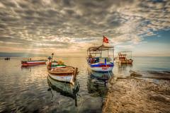 Sun touch (Nejdet Duzen) Tags: trip morning travel sea holiday beach sunrise turkey boat trkiye deniz sabah sandal izmir tatil cludy turkei seyahat plaj gndoumu bulutlu rkmez doanbey