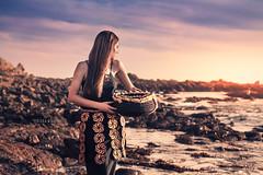 Tongan Girl with Basket #2 (*KIKITA*) Tags: sunset portrait woman beach girl beautiful female polynesia coast costume belt rocks outdoor traditional longhair teen diana portraiture teenager redhair cultural tonga polynesian tongan taahine nikond90 polynesiangirl holdingbasket erickagiulianiphotography thetonganproject
