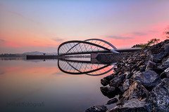 Momento (zollatiff) Tags: city longexposure morning travel bridge pink blue light sunset sky lake reflection nature water colors architecture clouds sunrise landscape dawn twilight nikon scenery rocks cityscape waterfront outdoor stones horizon structures peaceful calm momento harmony malaysia serene bluehour putrajaya scape tranquil foreground waterscape federalterritory leadingline putrajayamalaysia nikond7100 zollatiff wawasandam empanganwawasan nikkor1012