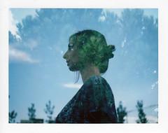 instant film (La fille renne) Tags: blue portrait tree green film girl silhouette pinetree polaroid outdoor doubleexposure multipleexposure fujifilm mx instantfilm fp100csilk polaroid330 psylvia polaroidautomatic330landcamera