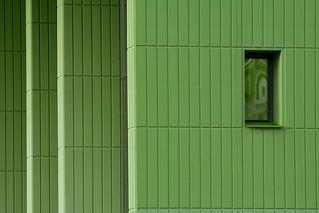 Three green pillars and a window